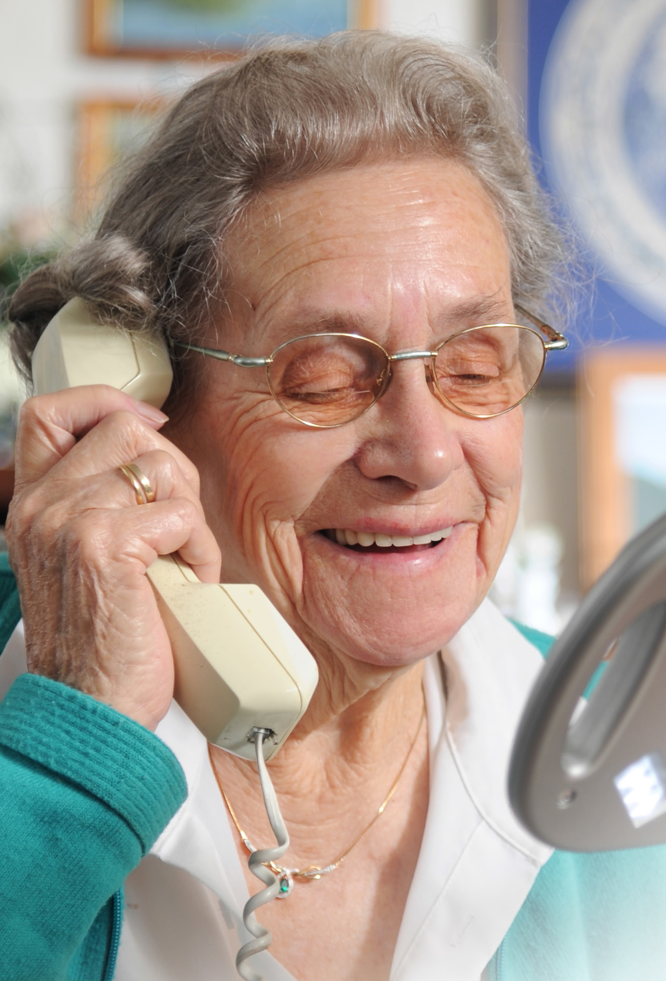 A photo of a woman on a telephone
