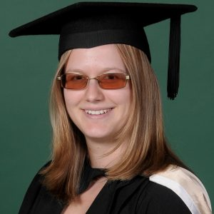 Image shows Olivia in her graduation robes.