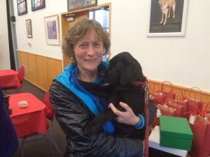 Jillian Potter hold a black puppy